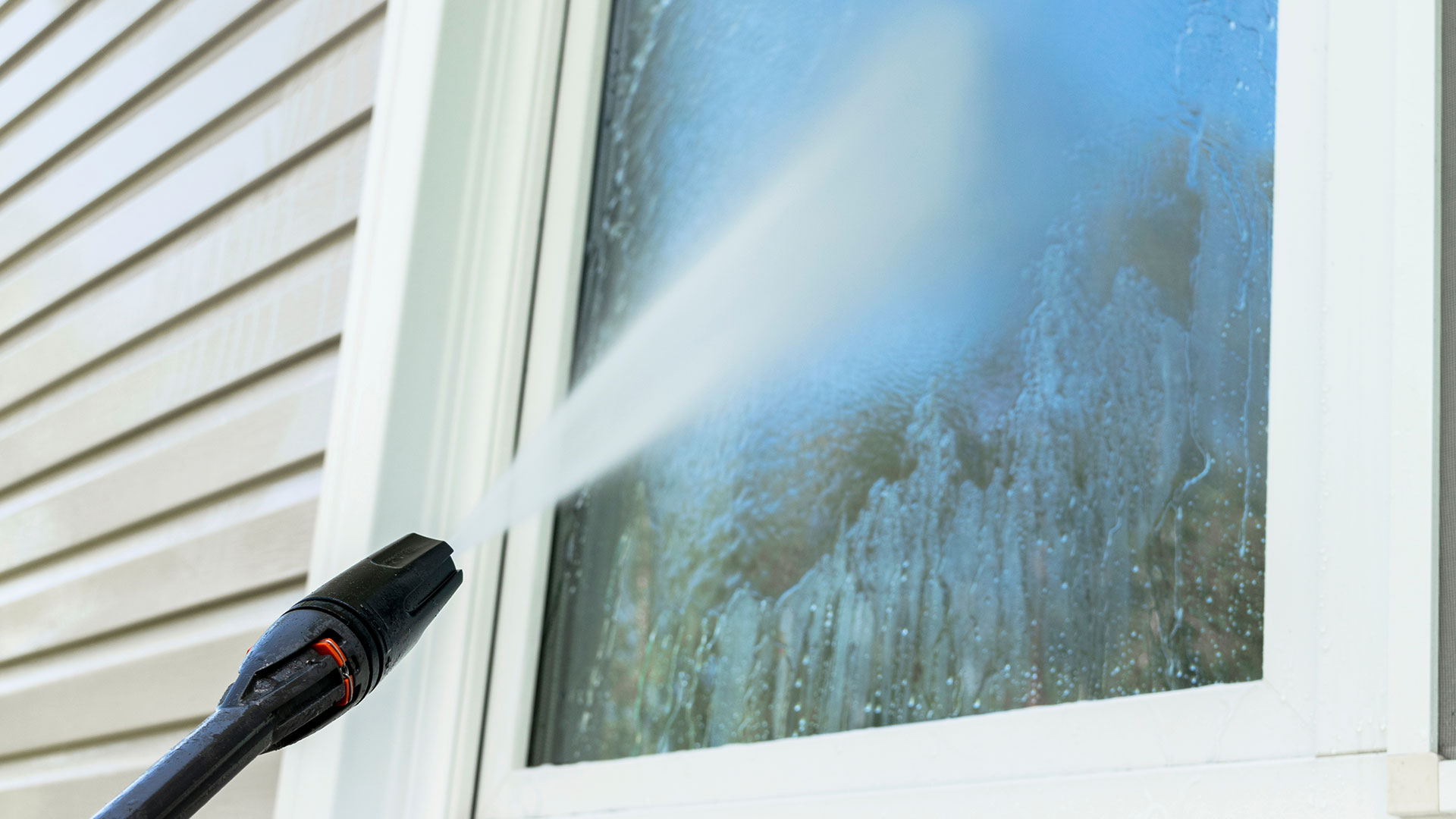 Window cleaning services at a home property in Calgary, Alberta.