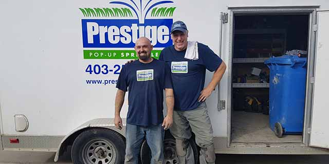 Prestige Outdoor Services work truck and owners in Calgary, Alberta